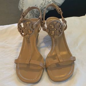 Tan leather sandal with wedge from Tory Burch.